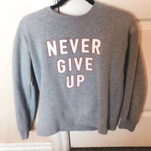 ~never give up grey crew neck
